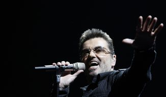 "FILE- In this June 25, 2008, file photo, singer George Michael performs during his ""Live Global Tour"" concert in Inglewood, Calif. Michael, who rocketed to stardom with WHAM! and went on to enjoy a long and celebrated solo career lined with controversies, has died, his publicist said Sunday, Dec. 25, 2016. He was 53. (AP Photo/Matt Sayles, File)"