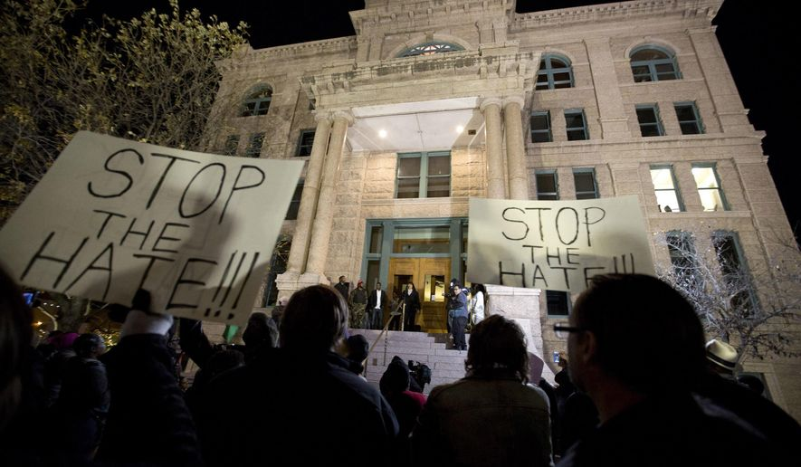 People protest against the Fort Worth Police Department at the Tarrant County Courthouse in Fort Worth, Texas, Thursday, Dec. 22, 2016. A white Texas police officer was placed on restricted duty Thursday while an internal investigation looks into a video showing the officer wrestling a black woman to the ground before arresting her and her two teenage daughters. (Joyce Marshall/Star-Telegram via AP)