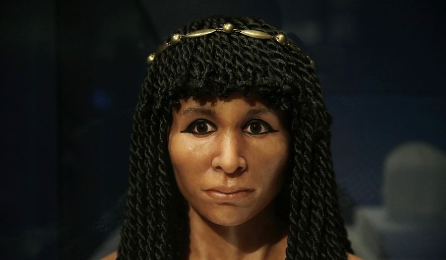 """FILE - In this Sept. 10, 2015 file photo, the reconstructed face of an Egyptian mummy known as the Gilded Lady is on display at the Natural History Museum, in Los Angeles. It is part of a traveling exhibition that used CT scanning to """"unwrap"""" ancient mummies and is an example of museums working to present exciting and meaningful exhibits by increasingly relying on technology. (AP Photo/Jae C. Hong, File)"""
