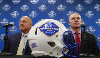 FILE - In this Wednesday, Dec. 7, 2016, file photo, Boston College head coach Steve Addazio, left, and Maryland head coach DJ Durkin speak at a news conference previewing the NCAA college football Quick Lane Bowl in Allen Park, Mich. Maryland and Boston College are meeting in the Motor City on Monday, Dec. 26. (AP Photo/Paul Sancya, File)