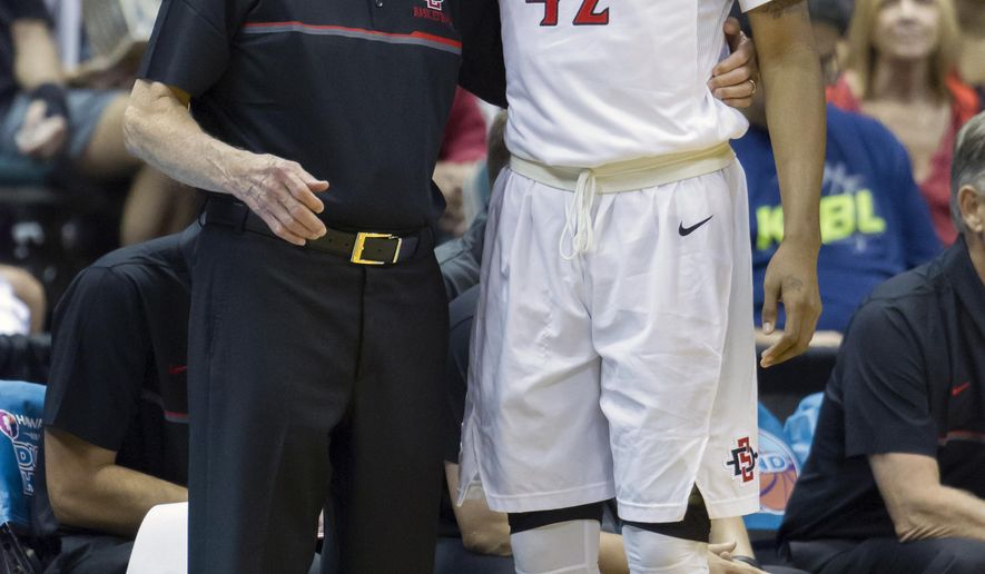 San Diego State head coach Steve Fisher provides guidance to guard Jeremy Hemsley (42) during the first half of an NCAA college basketball game against San Francisco at the Diamond Head Classic, Sunday, Dec. 25, 2016, in Honolulu. (AP Photo/Eugene Tanner)