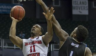 Illinois State forward MiKyle McIntosh (11) shoots a layup while being defended by Tulsa forward Martins Igbanu (1) during the second half of an NCAA college basketball game at the Diamond Head Classic, Sunday, Dec. 25, 2016, in Honolulu. Illinois State beat Tulsa 68-56. (AP Photo/Eugene Tanner)