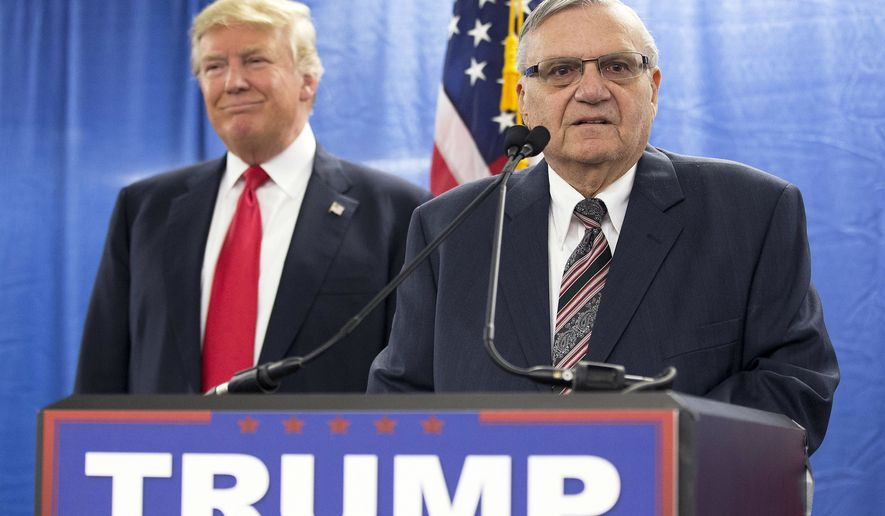 FILE - In this Jan. 26, 2016, file photo, Republican presidential candidate Donald Trump, left, is joined by Maricopa County, Ariz., Sheriff Joe Arpaio during a news conference in Marshalltown, Iowa. The longtime Maricopa County sheriff had a tough year. He was voted out of office in November, losing to Democrat Paul Penzone amid lingering frustration over his legal issues and costs. He also was charged with criminal contempt of court over his defiance of a judges orders in a racial profiling case. (AP Photo/Mary Altaffer, File)