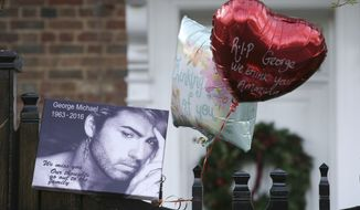 "Tributes are left on the gate outside the home of British musician George Michael in London, Monday, Dec. 26, 2016. On Dec. 30, authorities released a statement saying an autopsy was ""inconclusive"" but that circumstances of his passing were not ""suspicious.""  (AP Photo/Tim Ireland) **FILE**"