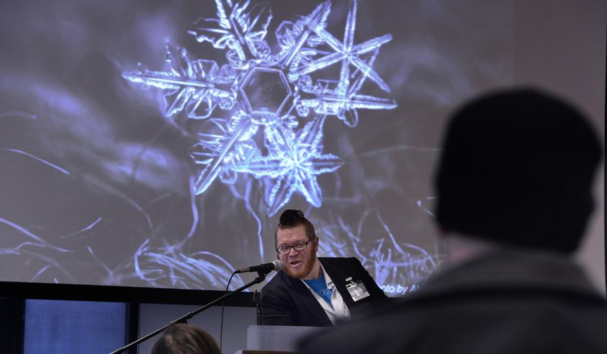 In this Dec. 9, 2016 photo, Sunday Assembly Vice Chairman Brian Worley speaks about the science behind the way snowflakes form during Sunday Assembly in Salt Lake City. The Salt Lake City atheist group is offering non-believers a church-like service that offers music, readings and community for those who don't belong to the state's dominant religion, Mormonism, or other faith groups. (Scott Sommerdorf/The Salt Lake Tribune via AP)