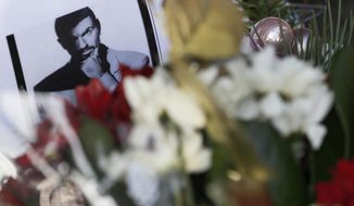 Tributes left outside the home of British musician George Michael in London, Monday, Dec. 26, 2016. George Michael, who rocketed to stardom with WHAM! and went on to enjoy a long and celebrated solo career lined with controversies, has died, his publicist said Sunday. He was 53. (AP Photo/Kirsty Wigglesworth)