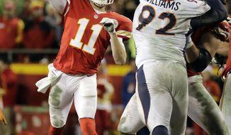 Kansas City Chiefs quarterback Alex Smith (11) throws as Denver Broncos linebacker Todd Davis (51) closes in, during the second half of an NFL football game in Kansas City, Mo., Sunday, Dec. 25, 2016. (AP Photo/Charlie Riedel)