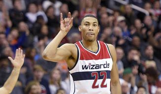 Washington Wizards forward Otto Porter Jr. (22) reacts after he scored a basket during the second half of an NBA basketball game against the Milwaukee Bucks, Monday, Dec. 26, 2016, in Washington. The Wizards won 107-102. (AP Photo/Nick Wass)