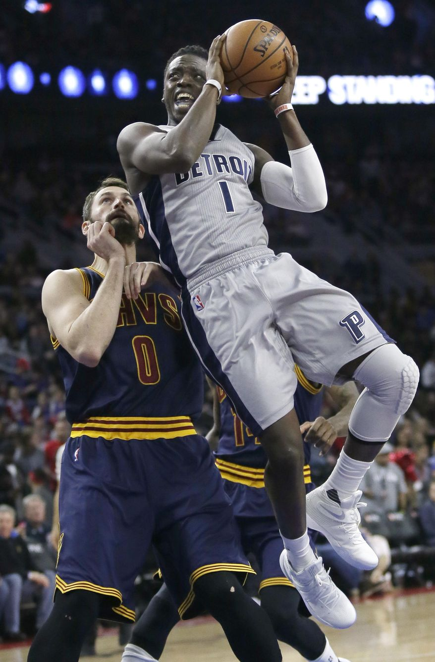 Detroit Pistons guard Reggie Jackson (1) goes to the basket past Cleveland Cavaliers forward Kevin Love (0) during the first half of an NBA basketball game Monday, Dec. 26, 2016, in Auburn Hills, Mich. (AP Photo/Duane Burleson)