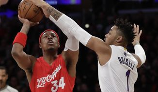Los Angeles Clippers forward Paul Pierce, left, shoots over Los Angeles Lakers guard D'Angelo Russell during the first half of an NBA basketball game in Los Angeles, Sunday, Dec. 25, 2016. (AP Photo/Chris Carlson)