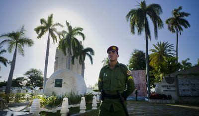FILE - In this Dec. 3, 2016 file photo, a soldier of the Revolutionary Armed Forces stands guard next to the tomb of Cuba's late leader Fidel Castro at Santa Ifigenia cemetery in Santiago, Cuba. Fidel's brother Raul must manage economic and diplomatic challenges during his last full year as president without his older brother whose presence endowed the system he created with historical weight and credibility in the eyes of many Cubans. Fidel died in November at age 90. (AP Photo/Ramon Espinosa, File)