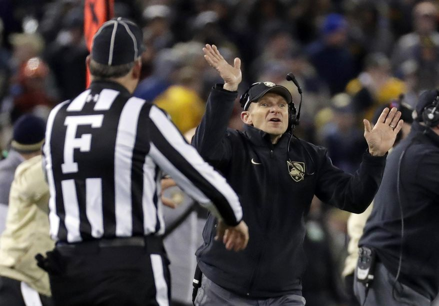FILE - In this Saturday, Dec. 10, 2016, file photo, Army head coach Jeff Monken, right, directs his players in the second half of the Army-Navy NCAA college football game in Baltimore. Army plays North Texas in the Heart of Dallas Bowl on Tuesday, Dec. 27. (AP Photo/Patrick Semansky, File)