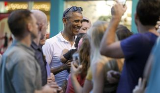 President Barack Obama greets people waiting for him outside Island Snow Hawaii in Kailua, Hawaii, Saturday, Dec. 24, 2016, after the president, joined by family and friends, had shave ice during the first family's annual vacation. (AP Photo/Carolyn Kaster)