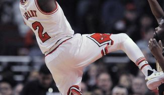 Chicago Bulls' Jerian Grant (2) goes up for a shot against Indiana Pacers' Aaron Brooks right, during the first half of an NBA basketball game, Monday, Dec. 26, 2016, in Chicago. (AP Photo/Paul Beaty)