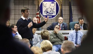 Scott Lockwood, left, executive vice president of the engineering firm of Anderson, Eckstein & Westrick, speaks about developments of a sinkhole at a public meeting at Fraser City Hall in Fraser, Mich. on Dec. 26, 2016. The suburban Detroit community has declared a state of emergency after a sinkhole began forming in one of its neighborhoods. (Robin Buckson/Detroit News via AP)