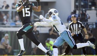 Jacksonville Jaguars wide receiver Allen Robinson (15) catches a pass in front of Tennessee Titans defensive back Valentino Blake during the first half of an NFL football game, Saturday, Dec. 24, 2016, in Jacksonville, Fla. (AP Photo/Phelan M. Ebenhack)