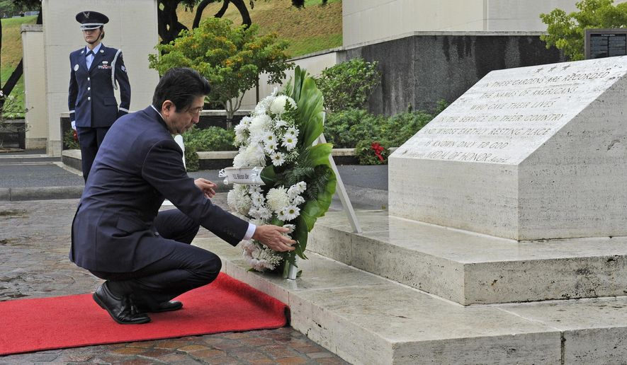 Japanese Prime Minister Shinzo Abe visits the National Memorial Cemetery of the Pacific to place a wreath at the Honolulu Memorial, Monday, Dec. 26, 2016, in Honolulu. (Bruce Asato/The Star-Advertiser via AP)