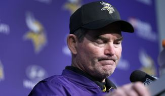 FILE - In this Dec. 18, 2016, file photo Minnesota Vikings head coach Mike Zimmer pauses while speaking to the media following an NFL football game against the Indianapolis Colts in Minneapolis. Given a contract extension the day before training camp began and the architect of a team that started 5-0,  Zimmer watched his Vikings unravel after that. Now they're eliminated from playoff contention, with one meaningless game left(AP Photo/Charlie Neibergall, File)