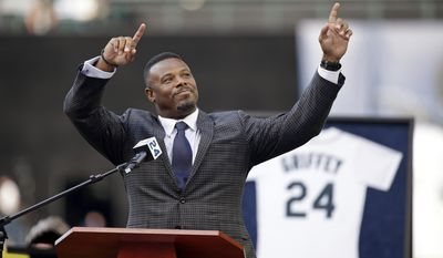 FILE - In this Aug. 7, 2016, file photo, former Seattle Mariners outfielder Ken Griffey Jr. raises his arms as he is introduced to speak during a ceremony honoring him for his induction into the Hall of Fame, before a baseball game between the Mariners and the Los Angeles Angels in Seattle. Griffey's induction into the Hall of Fame was among the top news stories in Washington state in 2016. (AP Photo/Elaine Thompson, File)