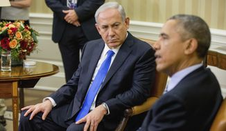 "FILE -- In this Nov. 9, 2015 file photo, President Barack Obama meets with Israeli Prime Minister Benjamin Netanyahu in the Oval Office of the White House in Washington. Doubling down on its public break with the Obama administration, a furious Israeli government said, Tuesday, Dec. 27, 2016, that it has ""ironclad"" information from Arab sources that Washington actively helped craft last week's U.N. resolution declaring Israeli settlements illegal. The allegations further poison the increasingly toxic atmosphere between Israel and the outgoing Obama administration in the wake of Friday's vote, and raise questions about whether the White House might take further action. (AP Photo/Andrew Harnik, File)"