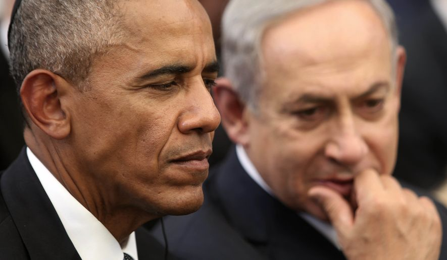 "U.S. President Barack Obama, left, and Israeli Prime Minister Benjamin Netanyahu talk during the funeral of former Israeli President and Prime minister Shimon Peres in Jerusalem, Sept. 30, 2016. Doubling down on its public break with the Obama administration, a furious Israeli government says it has ""ironclad"" information from Arab sources that Washington actively helped craft last week's U.N. resolution declaring Israeli settlements illegal. The allegations further poison the increasingly toxic atmosphere between Israel and the outgoing Obama administration in the wake of Friday's vote, and raise questions about whether the White House might take further action. (Menahem Kahana, Pool via AP, File) ** FILE **"