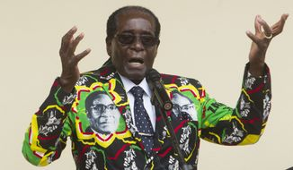 Zimbabwean President Robert Mugabe has called for all African Union members to quit the court en masse. (Associated Press)
