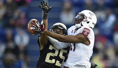 Temple wide receiver Adonis Jennings is fouled by Wake Forest cornerback Brad Watson during the first half of the Military Bowl NCAA college football game, Tuesday, Dec. 27, 2016 in Annapolis, Md. (AP Photo/Gail Burton)
