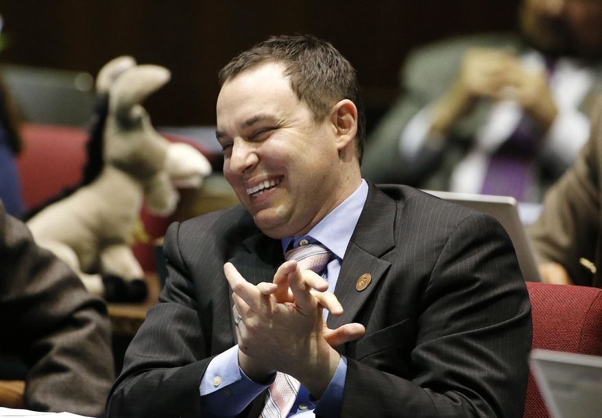 FILE - In this March 4, 2015 file photo, Rep. J.D. Mesnard, R-Chandler, smiles as he listens during the legislative session at the state Capitol in Phoenix. Mesnard, Arizona's new House speaker, will formally take the reins in early January when the Legislature begins its session. (AP Photo/Ross D. Franklin, File)