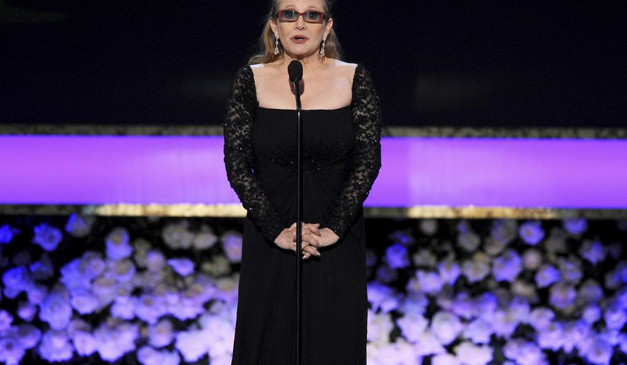 FILE - In this Sunday, Jan. 25, 2015 file photo, Carrie Fisher presents the life achievement award on stage at the 21st annual Screen Actors Guild Awards at the Shrine Auditorium in Los Angeles. On Tuesday, Dec. 27, 2016, a publicist said Fisher has died at the age of 60. (Photo by Vince Bucci/Invision/AP, File)