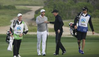 FILE - In a Friday, Feb. 12, 2016 file photo, Dustin Johnson, second from left, is greeted by playing partner Wayne Gretzky, second from right, after making an eagle chip on the 10th green of the Monterey Peninsula Country Club Shore Course during the second round of the AT&T Pebble Beach National Pro-Am golf tournament, in Pebble Beach, Calif. (AP Photo/Eric Risberg, File)