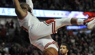 Chicago Bulls' Dwyane Wade dunks during the final seconds of the second half of an NBA basketball game against the Indiana Pacers, Monday, Dec. 26, 2016, in Chicago. Chicago won 90-85. (AP Photo/Paul Beaty)