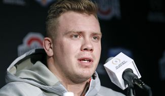 Ohio State's Pat Elflein speaks to the media after arriving with his team at Phoenix Sky Harbor Airport on Monday Dec. 26, 2016, in Phoenix. Ohio State will play Clemson in the Fiesta Bowl as part of the college football playoff semifinal on Dec. 31, 2016. (AP Photo/Ralph Freso)
