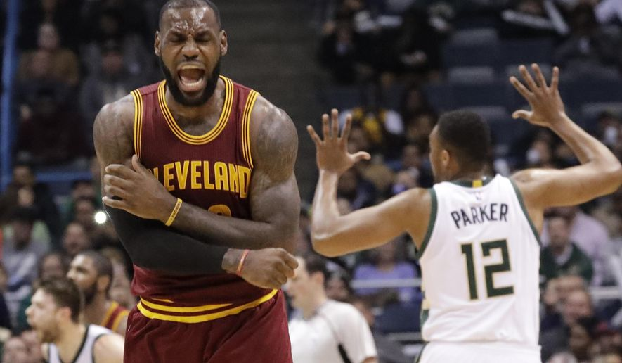 FILE - In this Nov. 29, 2016 file photo, Cleveland Cavaliers' LeBron James reacts to no call being called on his shot during the second half of an NBA basketball game against the Milwaukee Bucks in Milwaukee. On Tuesday, Dec. 27,  James, who ended 52 years of sports heartache by bringing Cleveland a championship and used his superstar platform to address social causes, was chosen as The Associated Press 2016 Male Athlete of the Year. (AP Photo/Morry Gash, File)