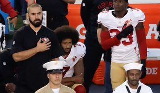 San Francisco 49ers quarterback Colin Kaepernick either remained seated or took a knee during the national anthem before several NFL games this season as forms of protest against social injustice. Kaepernick's actions became one of the stories of the year and spurred other athletes to follow suit in various ways. (ASSOCIATED PRESS PHOTOGRAPHS)