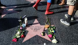 "An impromptu memorial created on a blank Hollywood Walk of Fame star by fans of late actress and author Carrie Fisher, who does not have an official star on the world-famous promenade, is seen in Los Angeles Wednesday, Dec. 28, 2016. Paste-on letters spell out her name and the phrase ""May the force be with you always. Hope."" (AP Photo/Reed Saxon)"