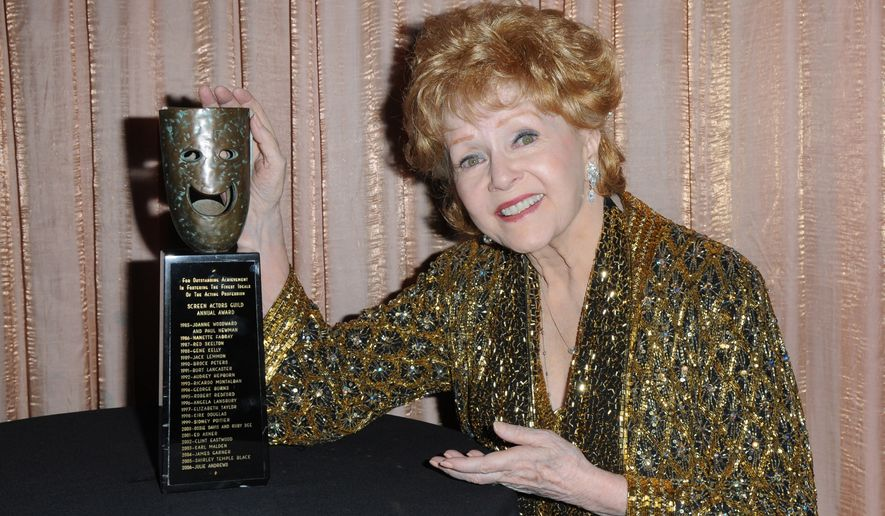 SAG Lifetime Achievement Award winner Debbie Reynolds is seen backstage at the 21st annual Screen Actors Guild Awards on Jan. 25, 2015, at the Shrine Auditorium in Los Angeles. (Associated Press)