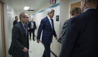 Secretary of State John Kerry walks into an interview after speaking at the State Department in Washington, Wednesday, Dec. 28, 2016. Stepping into a raging diplomatic argument, Kerry staunchly defended the Obama administration's decision to allow the U.N. Security Council to declare Israeli settlements illegal and warned that Israel's very future as a democracy is at stake. (AP Photo/Andrew Harnik)