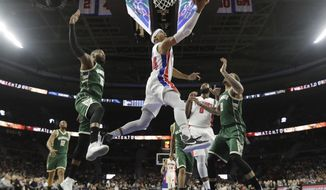Detroit Pistons forward Tobias Harris makes a layup during the first half of an NBA basketball game against the Milwaukee Bucks, Wednesday, Dec. 28, 2016, in Auburn Hills, Mich. (AP Photo/Carlos Osorio)
