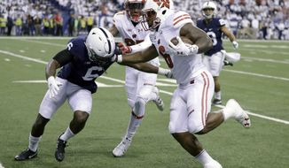 FILE - In a Saturday, Dec. 3, 2016 file photo, Wisconsin's Corey Clement, right, runs with the ball past Penn State's Malik Golden, left, for a 67-yard touchdown during the first half of the Big Ten championship NCAA college football game, in Indianapolis. (AP Photo/Michael Conroy, File)