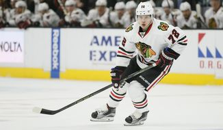 FILE - This Nov. 26, 2016 file photo shows Chicago Blackhawks left wing Artemi Panarin skating during the first period of an NHL hockey game against the Los Angeles Kings in Los Angeles. Panarin and the Chicago Blackhawks have agreed to terms on a $12 million, two-year contract extension, Wednesday, Dec. 28, 2016. (AP Photo/Danny Moloshok, file)