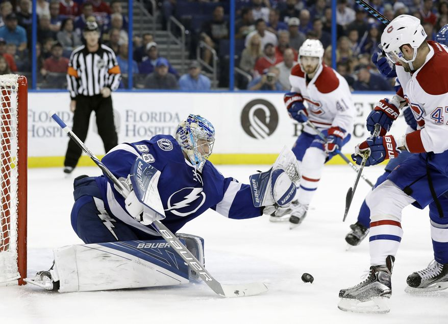 Tampa Bay Lightning goalie Andrei Vasilevskiy (88), of Russia, can't hang onto the puck after making a save on a shot by Montreal Canadiens right wing Alexander Radulov (47) during the first period of an NHL hockey game Wednesday, Dec. 28, 2016, in Tampa, Fla. (AP Photo/Chris O'Meara)