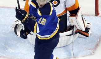 St. Louis Blues' Jori Lehtera, of Finland, celebrates a goal by teammate Kevin Shattenkirk as Philadelphia Flyers goalie Steve Mason, rear, watches during the first period of an NHL hockey game, Wednesday, Dec. 28, 2016, in St. Louis. (AP Photo/Jeff Roberson)