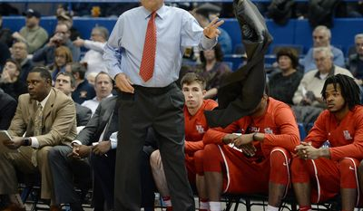 Houston head coach Kelvin Sampson tosses his jacket as he watches play in the first half of an NCAA college basketball game against Connecticut, Wednesday, Dec. 28, 2016, in Hartford, Conn. (AP Photo/Jessica Hill)
