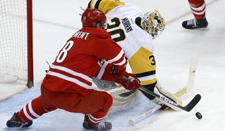 Pittsburgh Penguins goalie Matt Murray (30) blocks a shot by Carolina Hurricanes' Jay McClement (18) in the first period of an NHL hockey game in Pittsburgh, Wednesday, Dec. 28, 2016. (AP Photo/Gene J. Puskar)