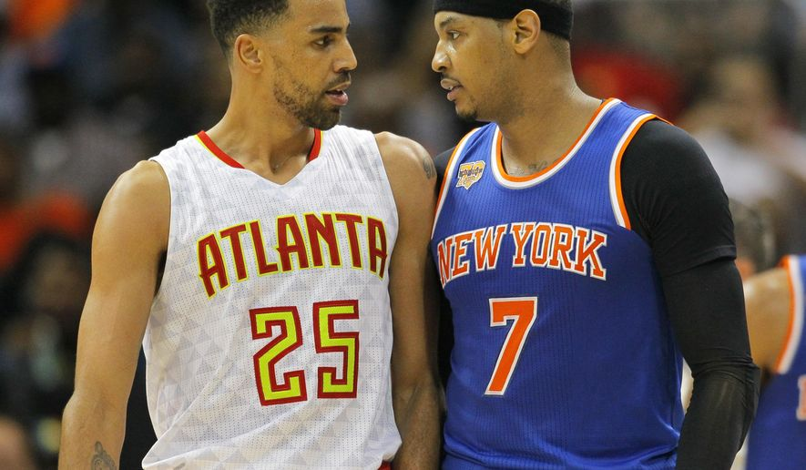 Atlanta Hawks' Thabo Sefolosha (25) and New York Knicks' Carmelo Anthony (7) confront each other after a technical foul is called on each of them during the first half of an NBA basketball game on Wednesday, Dec. 28, 2016, in Atlanta. Anthony was ejected from the game. (AP Photo/Todd Kirkland)