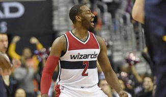 Washington Wizards guard John Wall reacts during the second half of the team's NBA basketball game against the Indiana Pacers, Wednesday, Dec. 28, 2016, in Washington. The Wizards won 111-105. (AP Photo/Nick Wass)