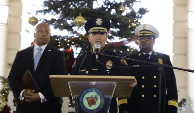 Pasadena Police Chief Phillip Sanchez, center, speaks about safety issues ahead of next week's 128th Rose Parade as he is joined by Pasadena Fire Chief Bertral Washington, background right, and Rob Savage, special agent in charge of the U.S. Secret Service Wednesday, Dec. 28, 2016, in Pasadena, Calif. (AP Photo/Jae C. Hong)