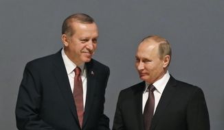 In this Oct. 10, 2016, file photo, Turkey's President Recep Tayyip Erdogan, left and Russian President Vladimir Putin, shake hands following the group photo at the World Energy Congress, in Istanbul, Turkey. (AP Photo/Emrah Gurel, File)