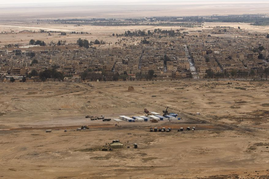 In this April 14, 2016, file photo, a Russian military camp is seen at the ancient city of Palmyra in the central city of Homs, Syria. (AP Photo/Hassan Ammar, File)
