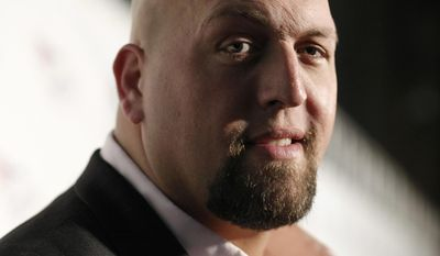 """FILE - In this Friday, Aug. 21, 2009, file photo, WWE Wrestler Big Show arrives at the World Wrestling Entertainment SummerSlam kickoff party benefiting Betty's Battle in Los Angeles. A story reported by a blog called """"WWE"""" that claimed professional wrestling star """"Big Show"""" had died in a car accident is false. Chris Bellitti, a spokesman for World Wrestling Entertainment, Inc., said Tuesday, Dec. 27, 2016, that the """"Big Show,"""" whose real name is Paul Donald Wight II, is alive and well. (AP Photo/Dan Steinberg, File)"""